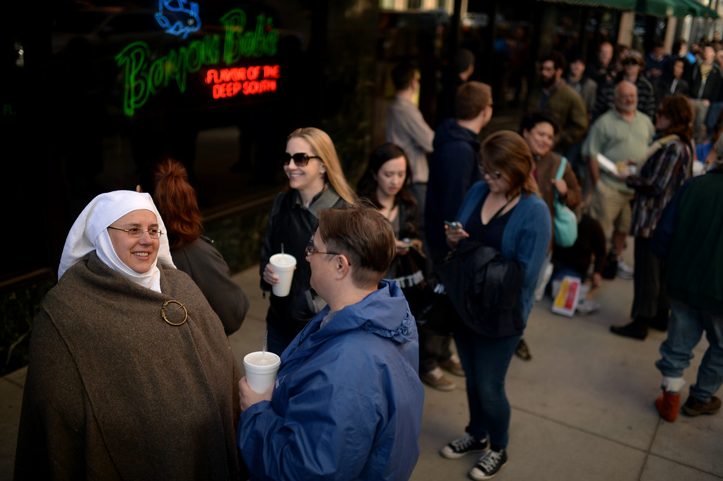 . Jen Kets, front left, and Kindel Brodigan, front right, are in the line of HBO\'s Game of Thrones premium show at Paramount Theatre Denver. Denver, Colorado. March 27. 2014. (Photo by Hyoung Chang/The Denver Post)