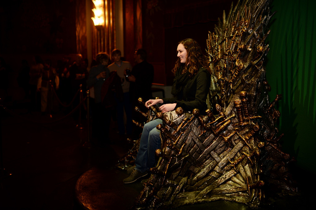 . Elizabeth Geister sits on the chair from HBO\'s Game of Thrones at Paramount Theater Denver. Denver, Colorado. March 27. 2014. (Photo by Hyoung Chang/The Denver Post)