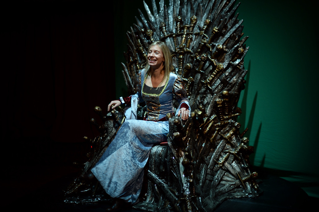 """. Sarah Finley sits on the chair from HBO\'s Game of Thrones at Paramount Theater Denver. Denver, Colorado. March 27. 2014. HBO hosted a party downtown Denver for fans of the popular series \""""Game of Thrones.\"""" Fans are invited to come celebrate the series - in costume - before the fourth season begins.(Photo by Hyoung Chang/The Denver Post)"""