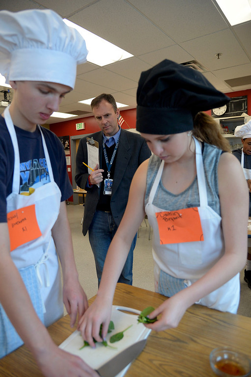 . Mark Wakefield carefully watches students during the Culinary Arts for Kidz cook off April 2, 2014 at Cresthill Middle School. (Photo by John Leyba/The Denver Post)