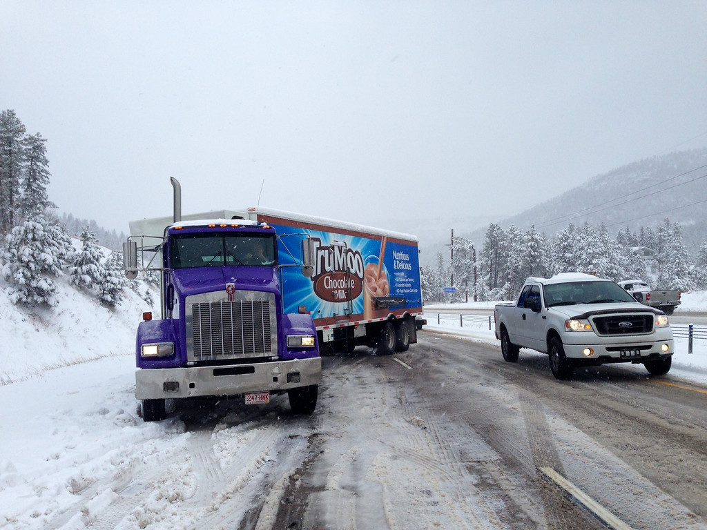 . Jackknifed truck blocking 285 S near the Sourdough Rd exit Thursday morning, April 3, 2014. (Photo by Joe Amon/The Denver Post)
