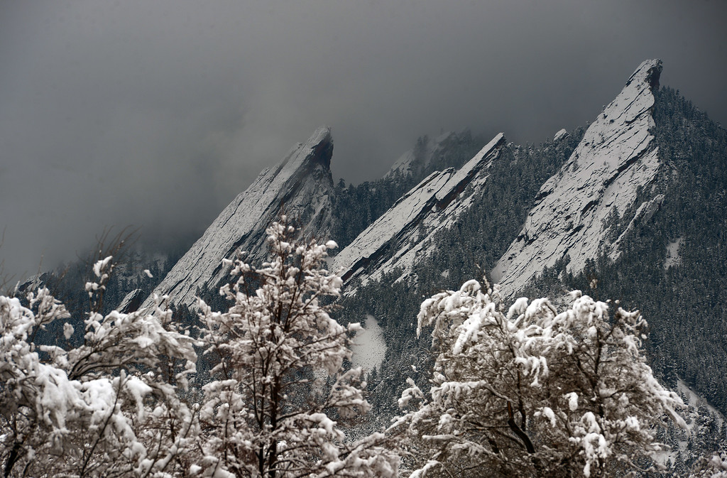 . The iconic Flatirons rock formation looked beautiful against dark morning clouds after a spring snowstorm brought heavy wet snow to Boulder, Co on April 3, 2014.   (Photo By Helen H. Richardson/ The Denver Post)