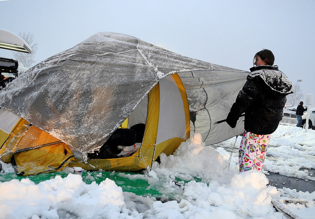 . Adrienne Jackson of Conifer takes down her tent after camping out for the night with almost 100 people for the Chick-Fil-A grand opening in Greenwood Village Thursday morning. She plans to donate her years supply of Chick-Fil-A to Mean Street Ministry to help the homeless. (Photo by Steve Nehf / The Denver Post)
