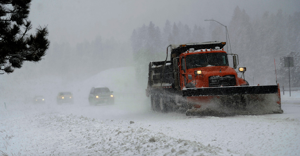 . A Snowplow clearing off ice and snow on Hwy 285 April 03, 2014 near Conifer, CO. (Photo By Joe Amon/The Denver Post)
