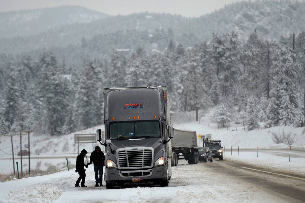 . Truckdrivers getting off the road to put on their chains trying to climbing Hwy 285 near Settlers Road April 03, 2014 Conifer, CO (Photo By Joe Amon/The Denver Post)