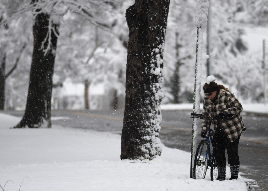 . A cyclist parks a bicycle at Washington Park in Denver, Colorado Thursday morning, April 3, 2014. (Photo by Hyoung Chang/The Denver Post)