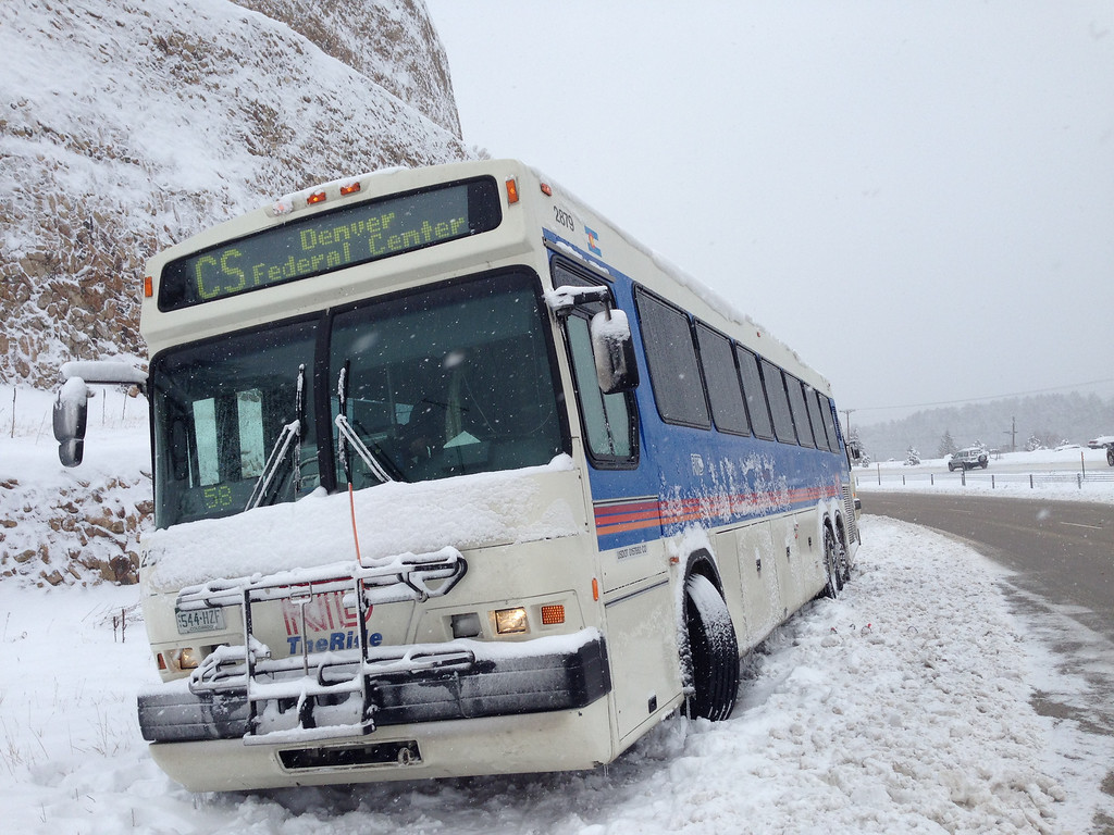 . An RTD bus sits off to the side of the road on 85 S. Near Doubleheader Rd. exit Thursday Morning, April 3, 2014. (Photo by Joe Amon/The Denver Post)