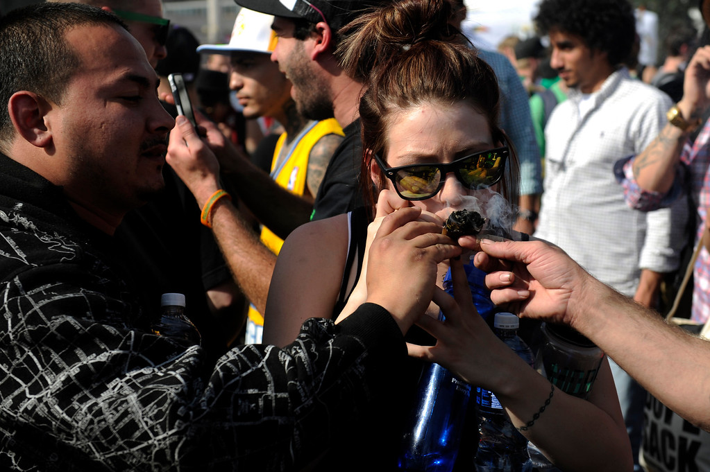 . People smoke pot as the clock strikes 4:20 during the 420 Rally at Civic Center Park in Denverlorado on April 20, 2014. (Photo by Seth McConnell/The Denver Post)
