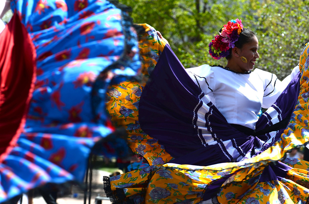 . Iskra Merino with the Omawari Mexican Folklore Dancers performs during the Cinco de Mayo celebrations at Civic Center Park in Denver, CO on May 24 2014. (Photo By Helen H. Richardson/ The Denver Post)
