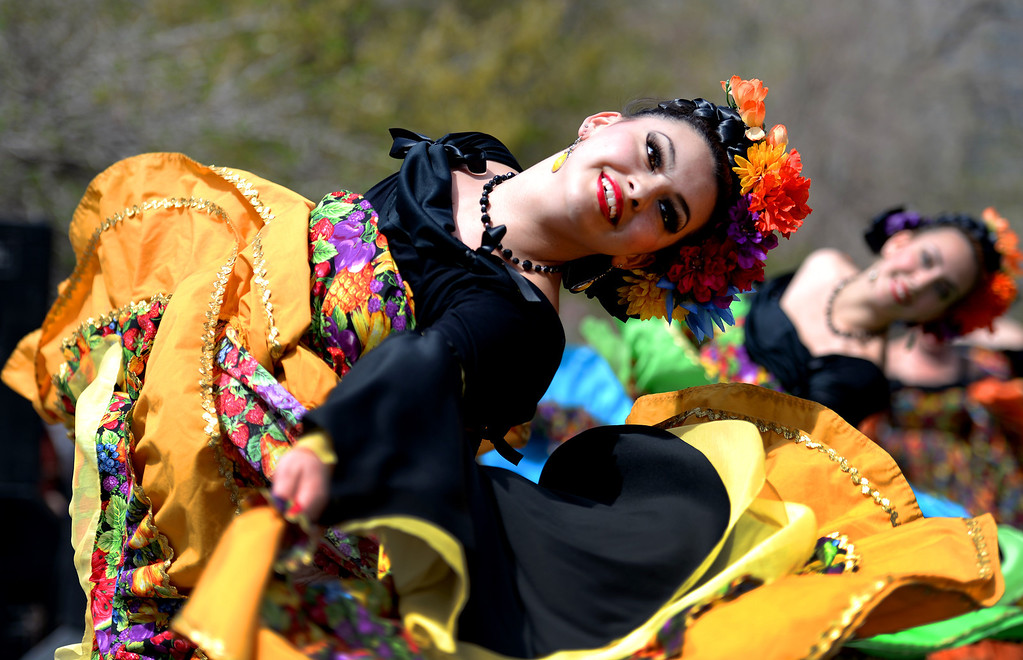 . Karina Ruiz-Solis performs the Costa de Sinaloa dance with other members of the Fiesta Colorado Dance Company during the Cinco de Mayo celebrations at Civic Center Park in Denver, CO on May 24 2014. (Photo By Helen H. Richardson/ The Denver Post)