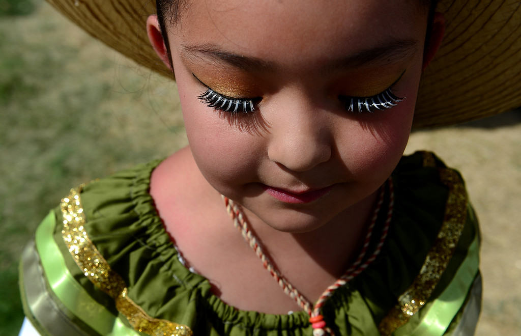 . Idalynne Garcia, 7, with the Colorado Mestizo Dancers, shows off her beautiful lashes before performing with her dance company during the Cinco de Mayo celebrations at Civic Center Park in Denver, CO on May 24 2014. (Photo By Helen H. Richardson/ The Denver Post)