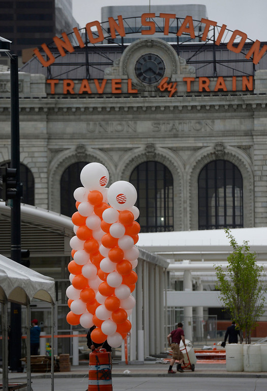 . Workers prepare for the grand opening of the Union Station Transit Center Friday morning, May 09, 2014. (Photo By Andy Cross / The Denver Post)