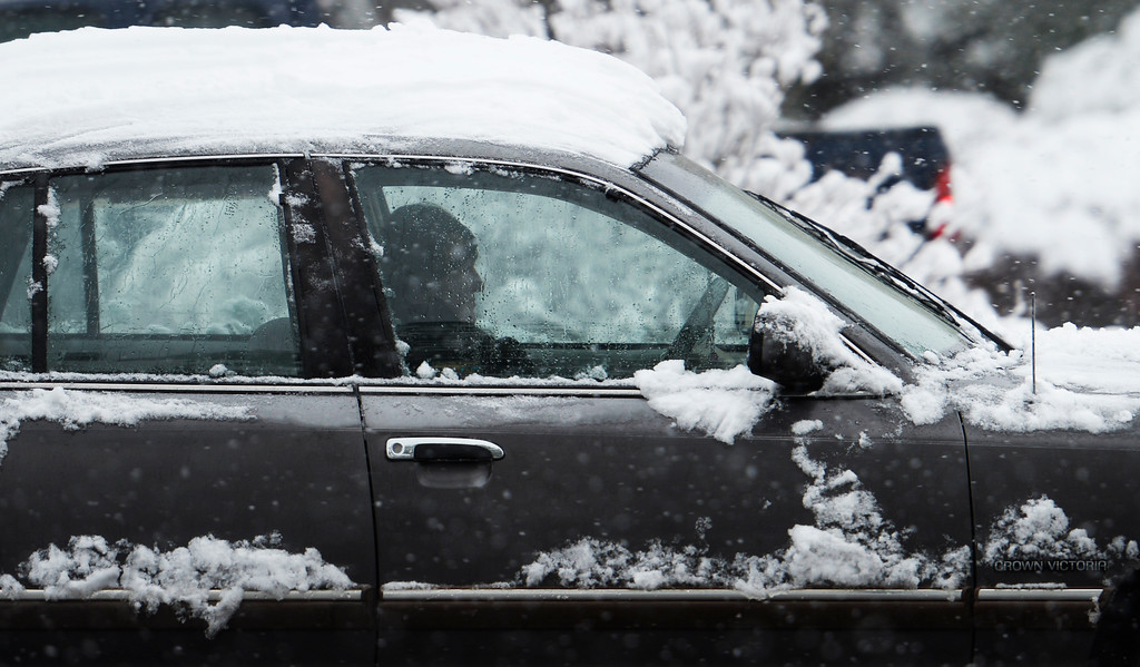 . t was a slow and snowy morning rush hour in Lakewood, May 12, 2014. A slow moving spring snow storm has blanketed the Denver area in new snow. (Photo by RJ Sangosti/The Denver Post)