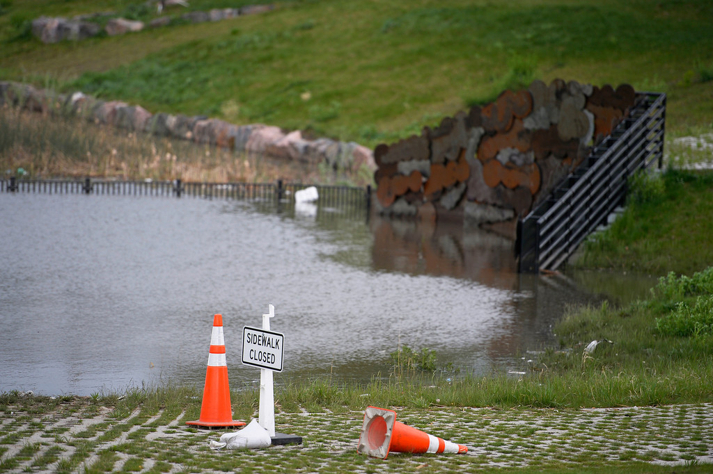 . Flooding cause tho closed the bike paths at Barnum Park May 25, 2014 as more weather threatens the area. Orange cones have been put in place on the paths. (Photo by John Leyba/The Denver Post)
