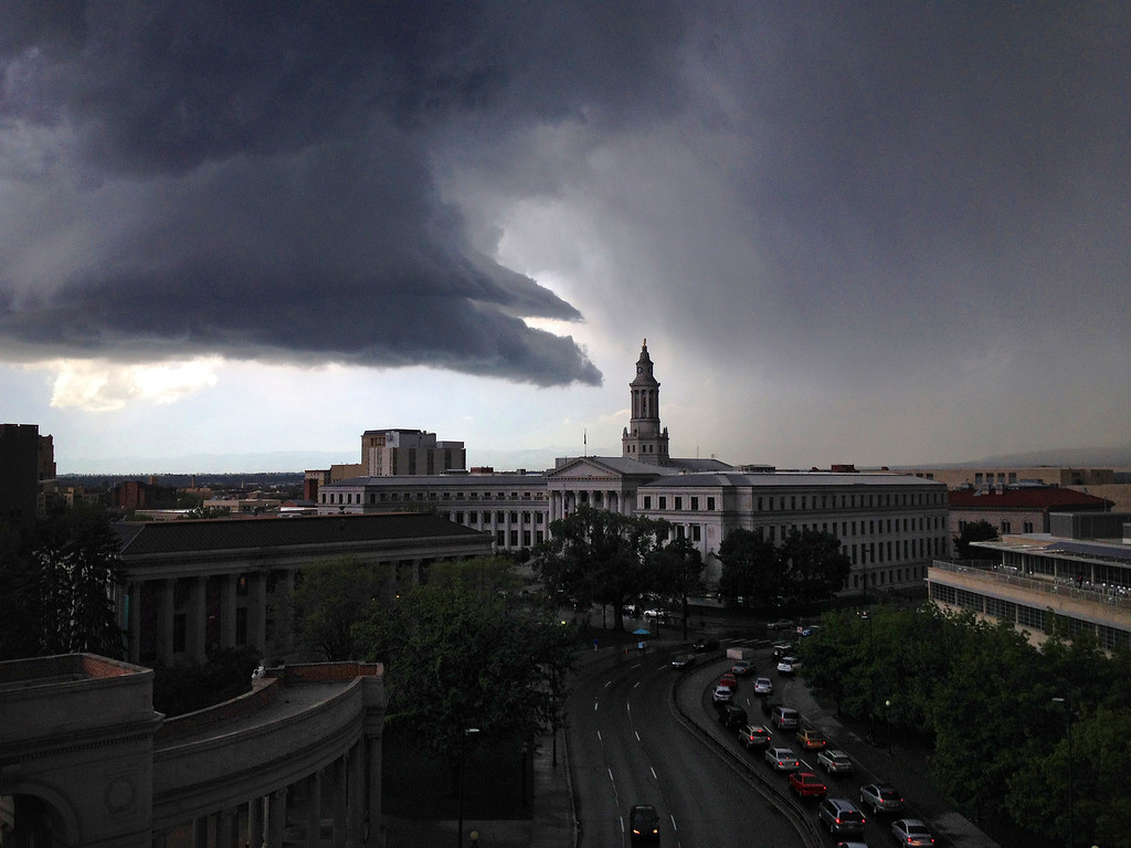 . Dark storm clouds amass over the Denver City and County Building around 2:30 in the afternoon, Thursday, May 22, 2014.  (Glen Barber, The Denver Post)