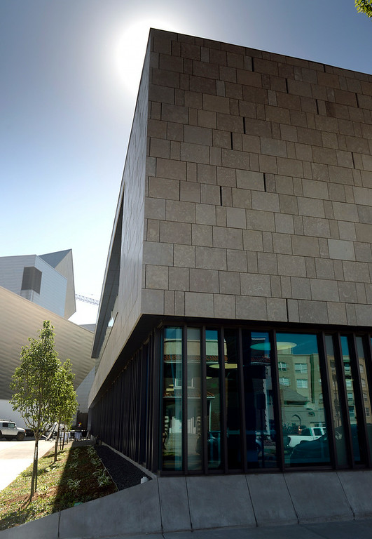 . The Denver Art Museum has built a new administrative building that next to the Hamilton Building, left, and the Clyfford Still Museum in Denver on Thursday, June 26, 2014.  (Denver Post Photo by Cyrus McCrimmon)