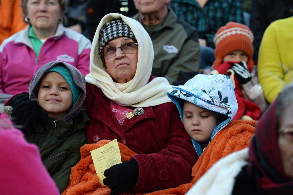 ". Maxine Weaver, middle, and her granddaughters Zoe Weaver, 10, left, and Aspen Weaver, 7, right, listen to the exuberant and passionate sermon given by superintendent Patrick L. Demmer during the 67th annual Easter sunrise service  at Red Rocks Amphitheater in Morrison, Colorado, on April 17, 2014.  Demmer\'s sermon was entitled ""What are you looking for?\"".  The popular annual event, which hosts thousands of worshipers, is sponsored by the Colorado Council of Churches.  (Photo By Helen H. Richardson/ The Denver Post)"