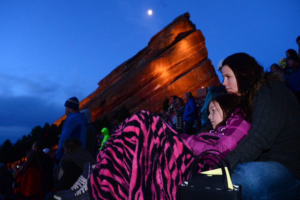". Kitty Olson and her daughter Kalie, 10, snuggle under warm blankets as the 67th annual Easter sunrise service  at Red Rocks Amphitheater in Morrison, Colorado, on April 17, 2014 gets under way.    Demmer\'s sermon was entitled ""What are you looking for?\"".  The popular annual event, which hosts thousands of worshipers, is sponsored by the Colorado Council of Churches.  (Photo By Helen H. Richardson/ The Denver Post)"