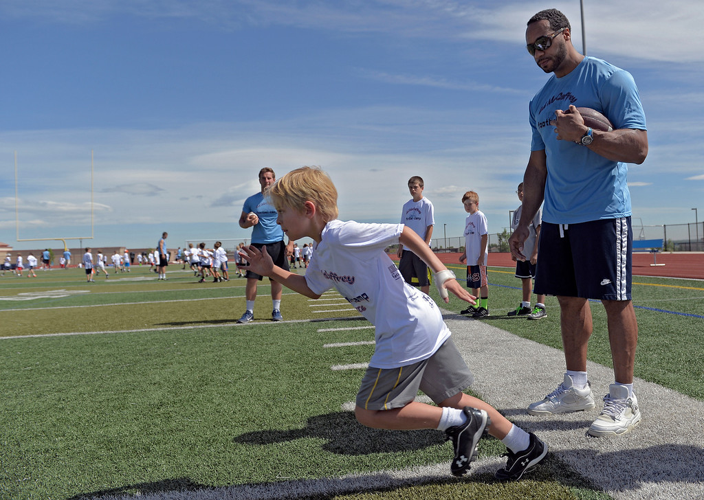 ". Former Broncos RB Kyle Johnson helps out during The Ed McCaffrey ""Open\"" Football Camp June 25, 2013 at Valor High School.  (Photo By John Leyba/The Denver Post)"