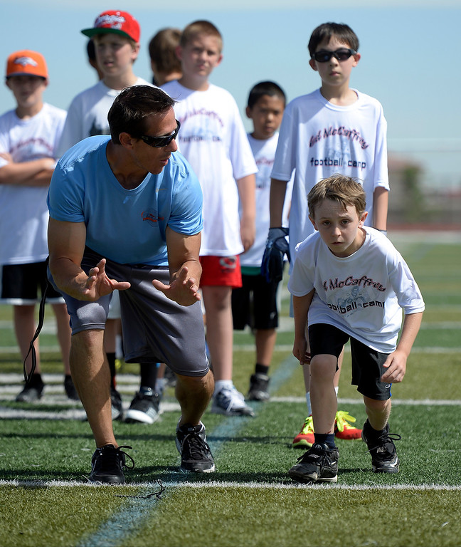 ". Trainer Loren Landow works with Logan Cass 10, of Parker during The Ed McCaffrey ""Open\"" Football Camp June 25, 2013 at Valor High School.   (Photo By John Leyba/The Denver Post)"