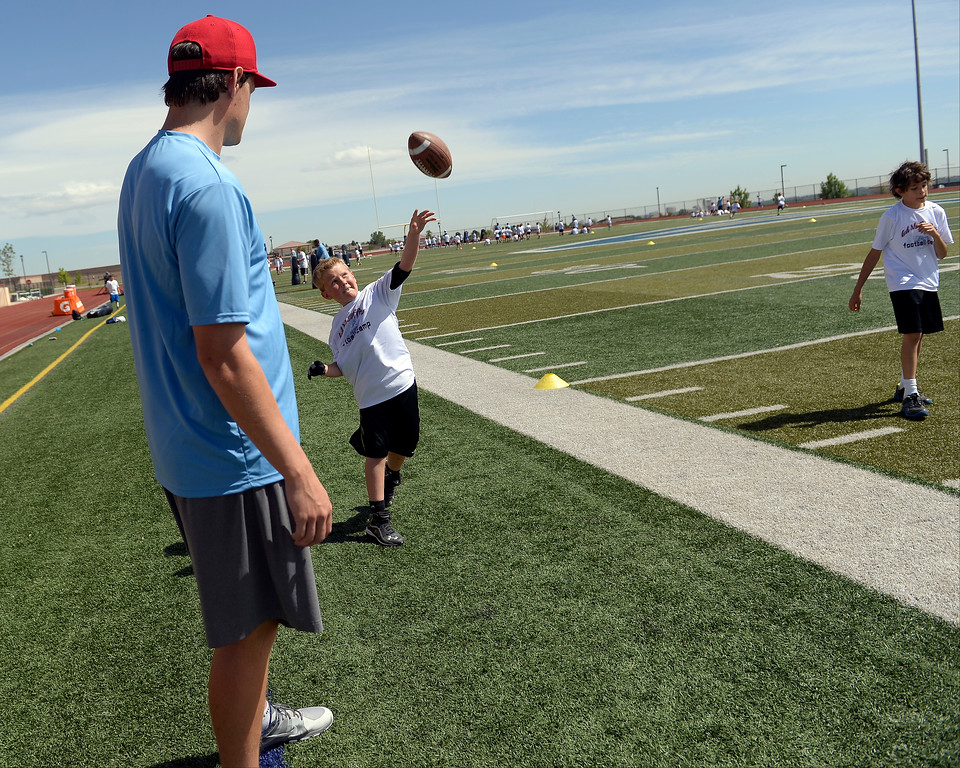 ". Miami Dolphins quarterback Aaron Corp helps out the quarterbacks during The Ed McCaffrey ""Open\"" Football Camp June 25, 2013 at Valor High School.   (Photo By John Leyba/The Denver Post)"