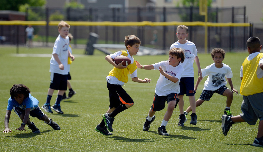 ". Campers play seven-on-seven during The Ed McCaffrey ""Open\"" Football Camp June 25, 2013 at Valor High School.   (Photo By John Leyba/The Denver Post)"