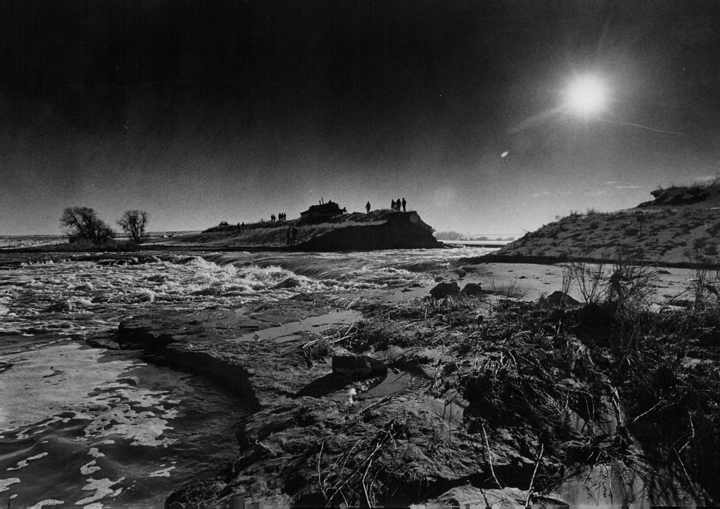 . FEB 10 1980  Water rushed through a break in an earthen dam in southeastern Weld County Sunday afternoon, and families in the rural area were urged to evacuate. The dam reportedly held 20,000 acre-feet of water behind it.  (John J. Sunderland/ The Denver Post)