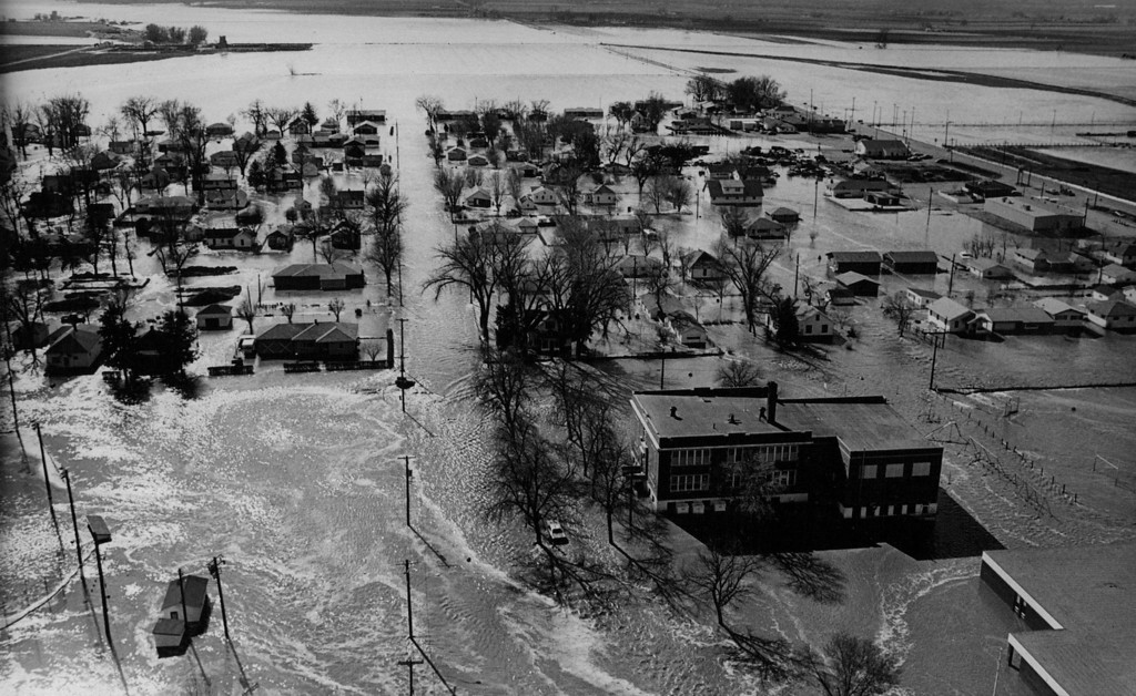 . APR 12 1973 - Kersey lies under water from the Latham Reservoir after the dam broke. The town was evacuated, with dogs and cats and occasional rescue worker only sign of life. (Barry Staver/ The Denver Post)