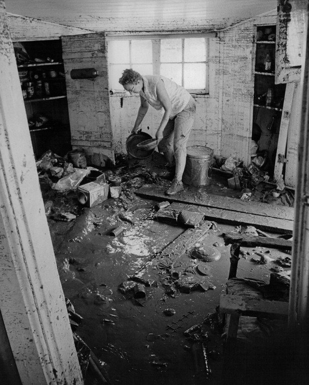 . JUN 20 1985  Floods - Denver. Mrs. Ethel Christensen of 365 S. Raleigh St., daughter, looks through what used to be the kitchen.  (Duane Howell/ The Denver Post)
