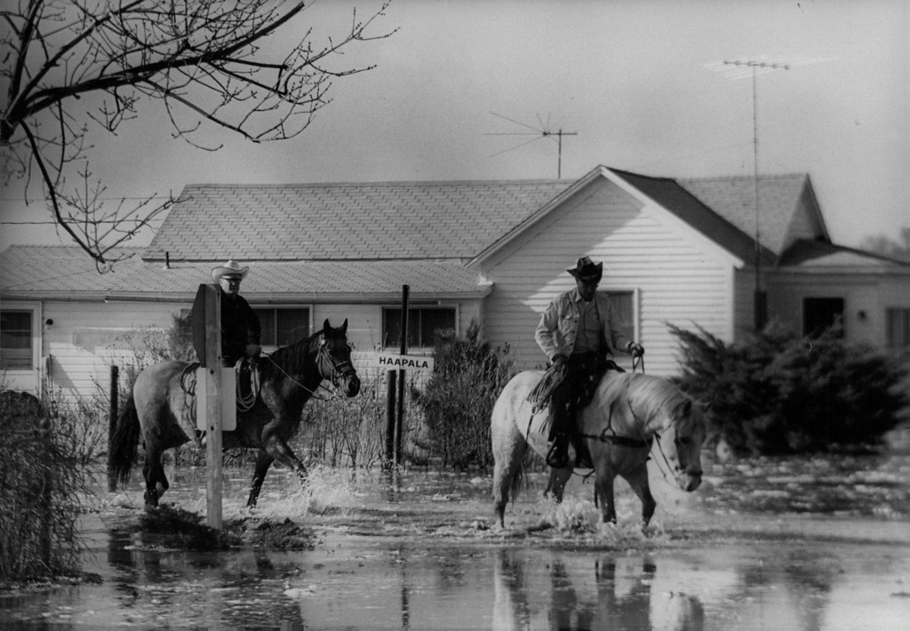 . APR 13 1973 - Horses provide 6 handy and reliable means of trans­portation as floodwaters limited motor-vehicle travel. Up to three or four feet of water covered the streets of the town of 900 persons seven miles east of Greeley. (Dave Buresh/ The Denver Post)