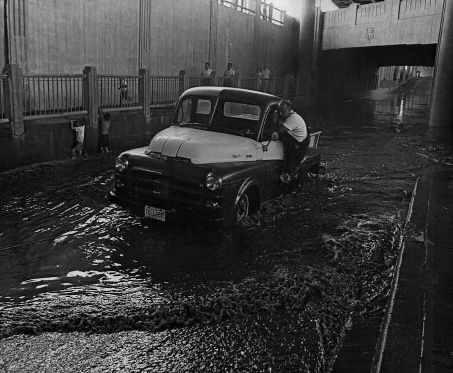 . JUL 20 1965  Floods - Denver. Fred Risen, 9241, Maneuver Blvd.  (Duane Howell/ The Denver Post)