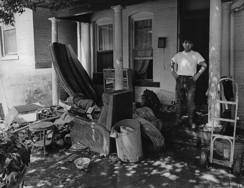 . JUN 20 1965  Floods - Denver. Henry Rubil, age 17 at 1517 Clay St.  (Duane Howell/ The Denver Post)