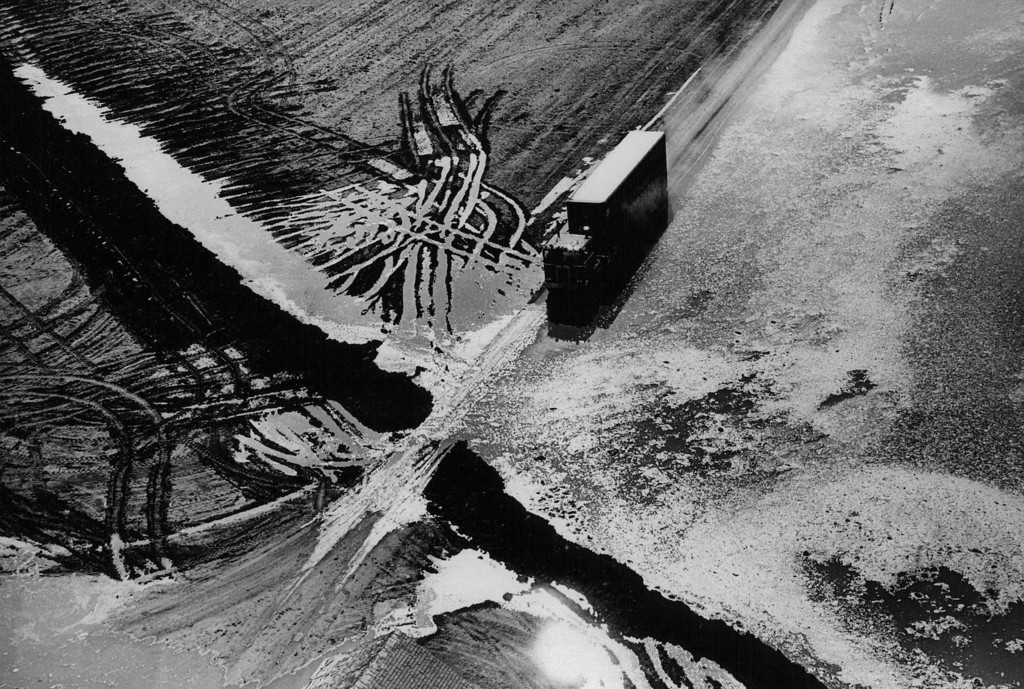 . APR 12 1973  A truck hauling cattle form an abandoned feed lot moves over a flooded road toward Kersey. At least two feedlots were evacuated to protect the cattle.  (Barry Staver/ The Denver Post)