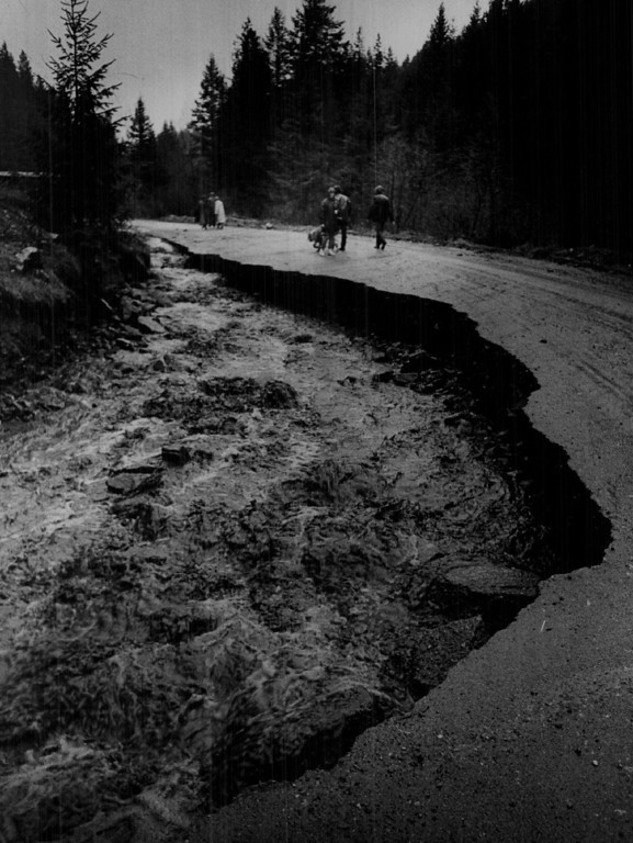 . MAY 6 1969  Nearly continuous rains since Sunday have sent streams out of their banks from Conifer southwest of Denver to Longmont area. Runoff water, not the creek, gouged this chunk of pavement out of South Deer Creek Road near Phillipsburg, Colo., Tuesday.  (Steve Larson/ The Denver Post)