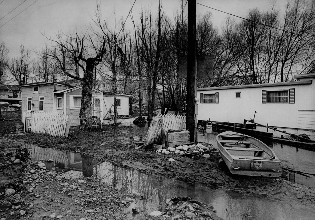 . APR 25 1974  WATER STANDS AROUND HOMES IN STEAMBOAT SPRINGS, COLO., CLOSEST TO RUNOFF-SWOLLEN YAMPA RIVER. Despite flood threat from river, most of the resort town in Routt County was back to normal activity Saturday.  (Dave Buresh/ The Denver Post)