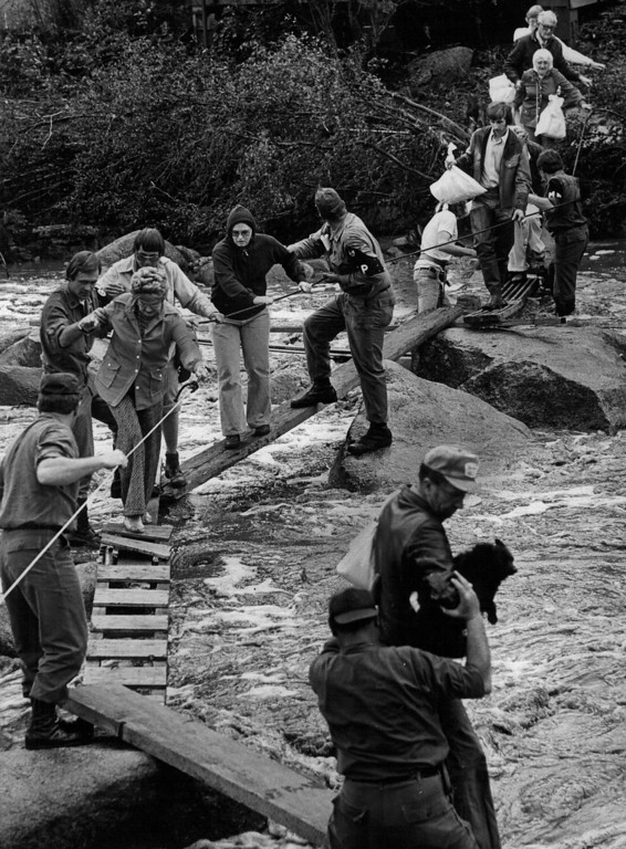 . AUG 1 1976 - Dogs, goods & people traverse big Thompson river. (Ernie Leyba/ The Denver Post)