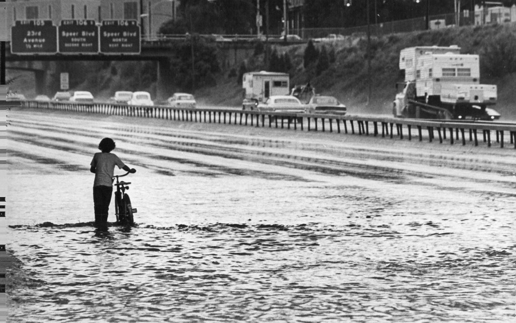 . JUL 20 1975  A young bicyclist wades through high water on Interstate 25 under 19th St. viaduct Sunday afternoon after a severe thunderstorm paralyzed parts of Denver area. The storm caused flash floods that closed some major roads and damaged some buildings.  (John J. Sunderland/ The Denver Post)