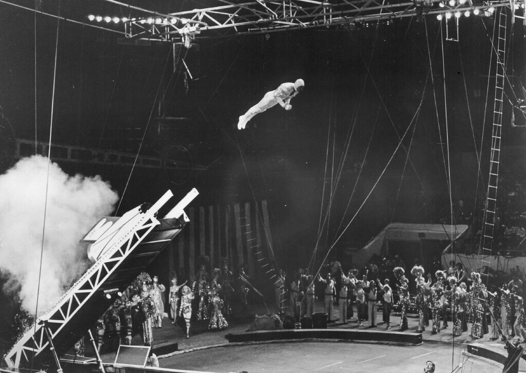 . OCT 5 1978 - Daredevil Elvin Bale is hurtled across the arena by a jet-propelled rocket launcher in the thrilling finale of the 108th Edition of Ringling Bros, and Barnum & Bailey Circus. (Denver Post digital archive photo)