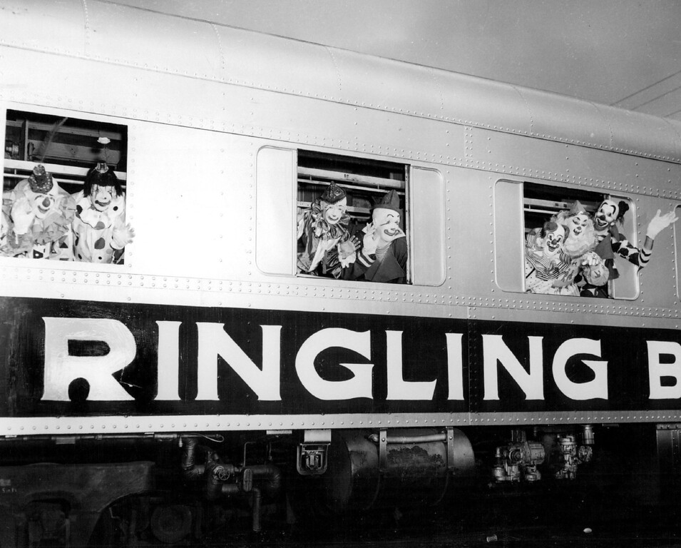 . JUL 20 1960, JUL 24 1960, FEB 27 1979, MAR 4 1979  Clowns wave from the Ringling Bros. Circus new troupe train  Credit: Dar-Zack Studio Labs, Inc.