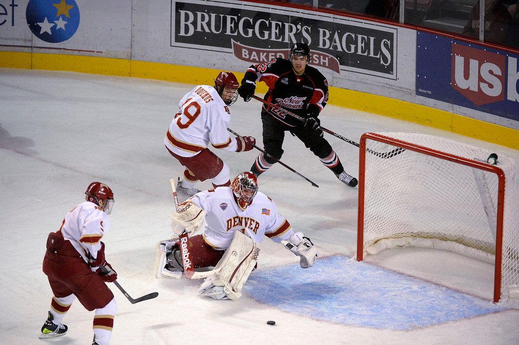 . Denver Pioneers G Sam Brittain (1) looks to cover up the puck during the first period against the University of New Brunswick October 6, 2013 at Magness Arena. (Photo by John Leyba/The Denver Post)