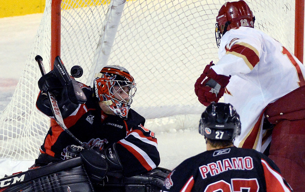 . University of New Brunswick G Charles Lavigne (31) makes a save as the puck sails over his stick side pad during the third period October 6, 2013 at Magness Arena. (Photo by John Leyba/The Denver Post)