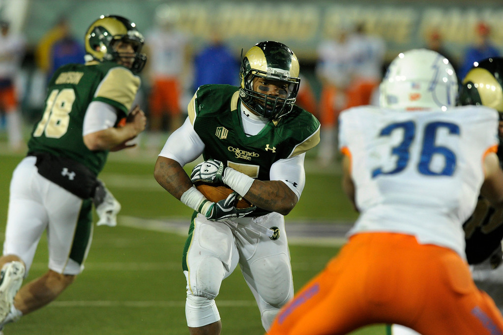 . FORT COLLINS, CO. - NOVEMBER 2: CSU running back Kapri Bibbs (5) looked for a hole on his fourth quarter touchdown carry. The Colorado State University football team fell to  Boise State 42-30 Saturday night, November 2, 2013. Photo By Karl Gehring/The Denver Post