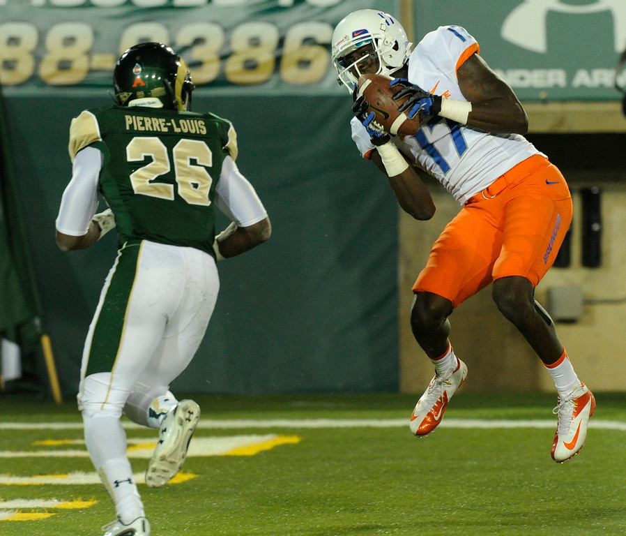 . FORT COLLINS, CO. - NOVEMBER 2: Boise State receiver Geraldo Boldewijn (17) hauls in a touchdown pass in front of CSU defensive back Kevin Pierre-Louis (26) in the second quarter. The Colorado State University football team hosted Boise State Saturday night, November 2, 2013. Photo By Karl Gehring/The Denver Post