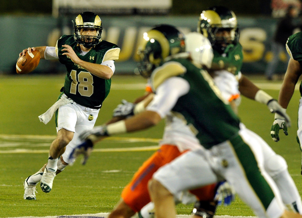 . FORT COLLINS, CO. - NOVEMBER 2: CSU quarterback Garrett Grayson (18) scrambled looking for a receiver in the first quarter. The Colorado State University football team hosted Boise State Saturday night, November 2, 2013. Photo By Karl Gehring/The Denver Post