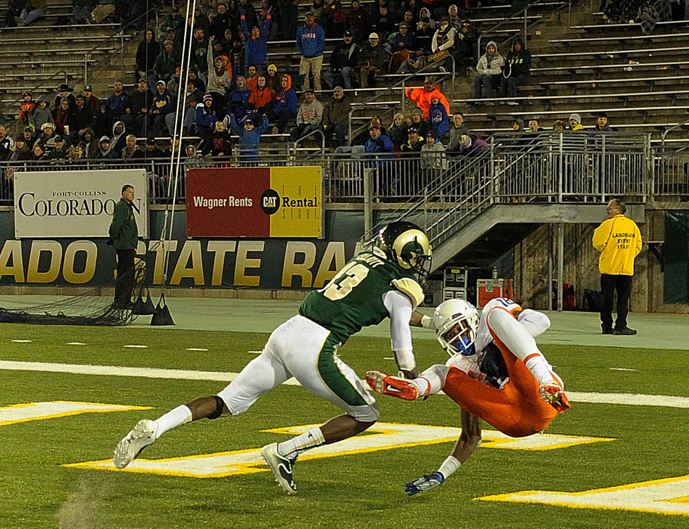. FORT COLLINS, CO. - NOVEMBER 2: Broncos wide receiver Aaron Burks (18) beat CSU defensive back DeAndre Elliott (13) for a touchdown in the third quarter. The Colorado State University football team fell to Boise State 42-30 Saturday night, November 2, 2013. Photo By Karl Gehring/The Denver Post