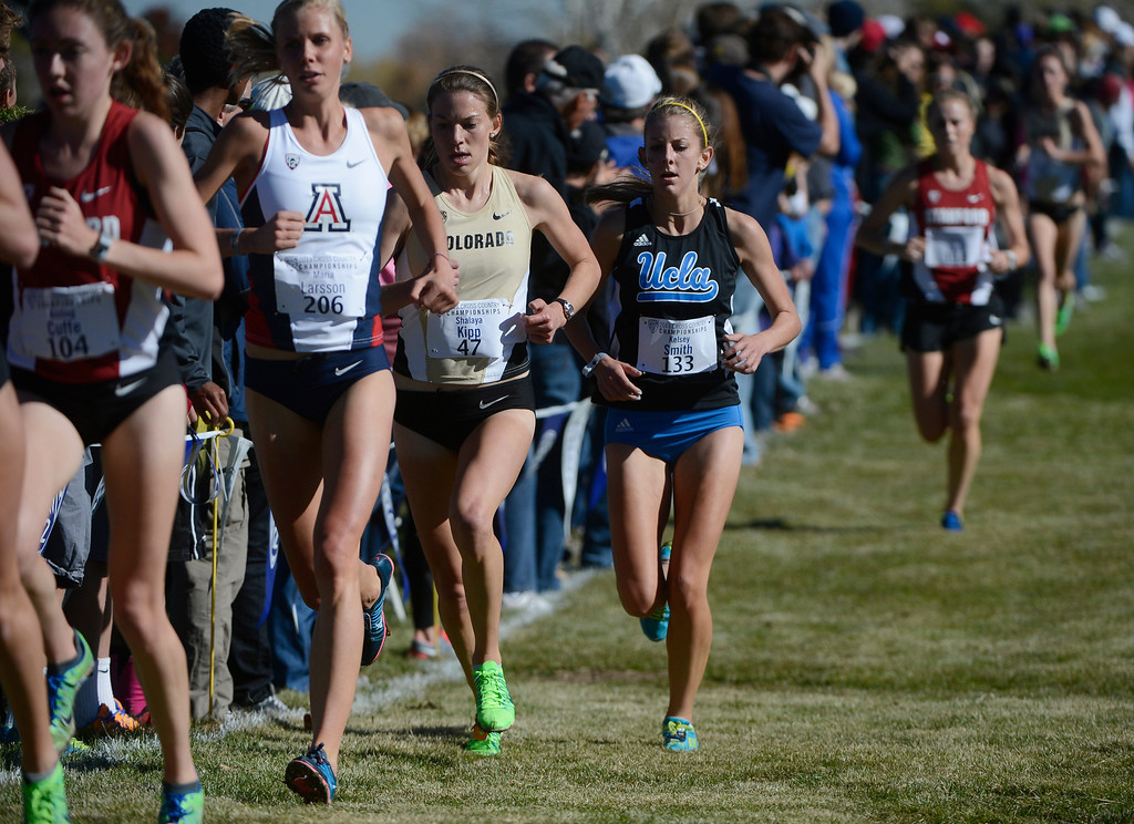 . LOUISVILLE, CO - NOVEMBER 02: Shalaya Kipp, Colorado, third from left, races down course against eventual race winner, Aisling Cuffe, left, #104, Stanford, left, Elvin Kibet, Arizona, #204, second from left, and Kelsey Smith, UCLA, #103 during the Pac 12 Cross Country Championships at the Coal Creek Golf Course Saturday morning, November 02, 2013. (Photo By Andy Cross/The Denver Post)