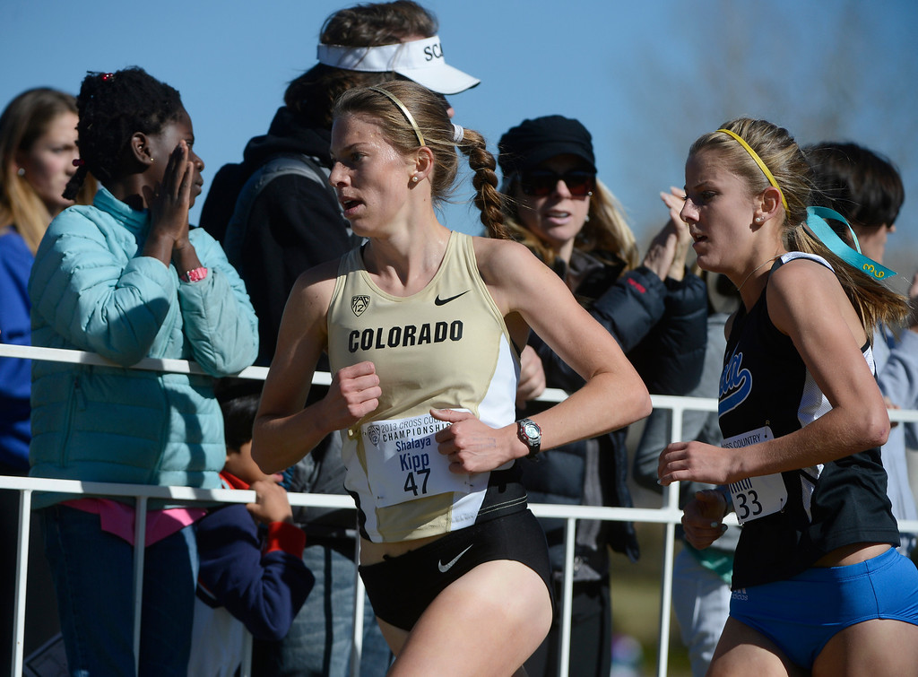 . LOUISVILLE, CO - NOVEMBER 02: Colorado University cross country runner, Shalaya Kipp, left, heads up course against, Kelsey Smith, UCLA, during the Pac 12 Cross Country Championships at the Coal Creek Golf Course Saturday morning, November 02, 2013. (Photo By Andy Cross/The Denver Post)