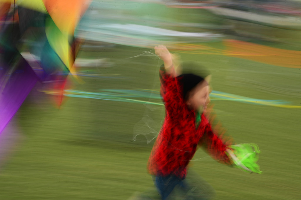 . A young boy tries to get his kite in the air during the 12th annual Arvada Kite Festival held at the Stenger soccer complex in Arvada, Colorado, on April 6, 2014.  Price and hundreds of other people braved cold temperatures , some rain and gusty winds to fly their kites  of all different sizes, shapes, and colors.  Activities included kite making classes and competitions for highest kite, smallest kite, largest kite and most visually appealing kite.  (Photo By Helen H. Richardson/ The Denver Post)