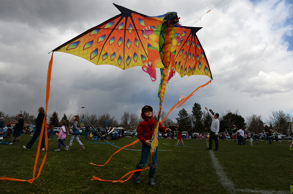 . Leo Price, 5, of Westminster, tries to get his dragon kite in the air during the 12th annual Arvada Kite Festival held at the Stenger soccer complex in Arvada, Colorado, on April 6, 2014.  Hundreds of people braved cold temperatures , some rain and gusty winds to fly their kites  of all different sizes, shapes, and colors.  Activities included kite making classes and competitions for highest kite, smallest kite, largest kite and most visually appealing kite.  (Photo By Helen H. Richardson/ The Denver Post)