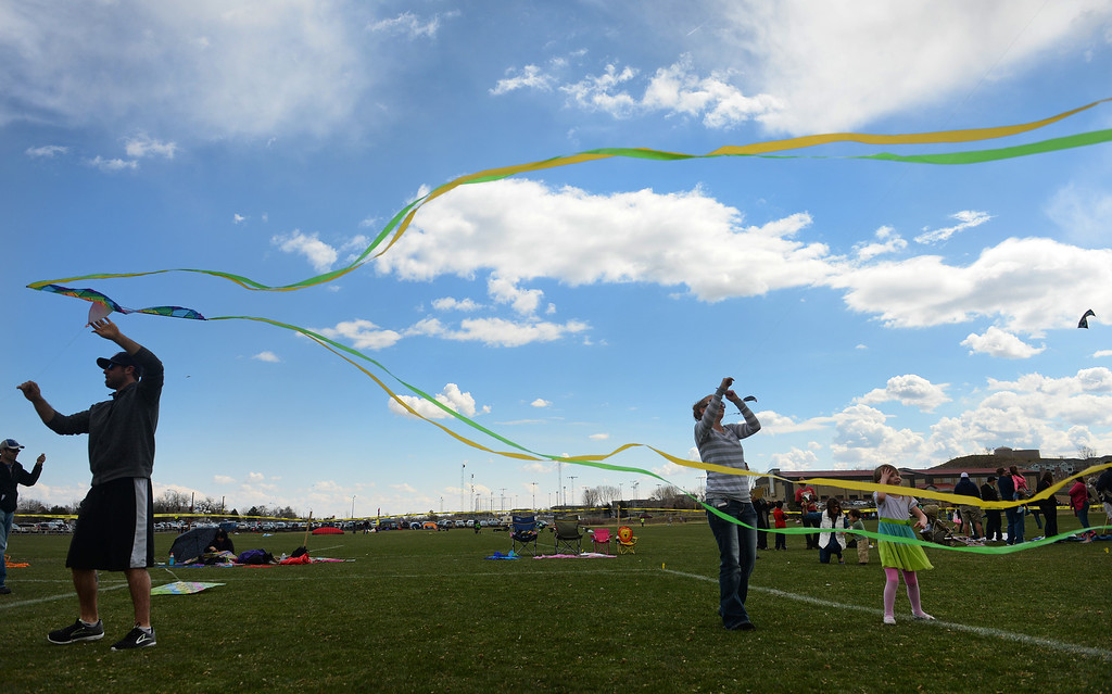 . Enthusiastic kite flyers try  to get their kites in the air during the 12th annual Arvada Kite Festival held at the Stenger soccer complex in Arvada, Colorado, on April 6, 2014.  Price and hundreds of other people braved cold temperatures , some rain and gusty winds to fly their kites  of all different sizes, shapes, and colors.  Activities included kite making classes and competitions for highest kite, smallest kite, largest kite and most visually appealing kite.  (Photo By Helen H. Richardson/ The Denver Post)